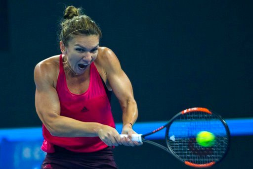 (AP Photo/Ng Han Guan). Simona Halep of Romania returns a shot from Caroline Garcia of France in the women's singles final match in the China Open tennis tournament at the Diamond Court in Beijing, China, Sunday, Oct. 8, 2017.