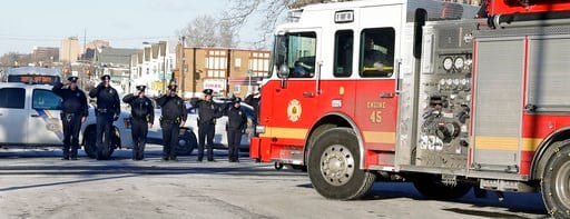 (Elizabeth Robertson/The Philadelphia Inquirer via AP). In this Saturday, Jan. 6, 2018, photo, Philadelphia police salute the procession for veteran firefighter Lieutenant Matthew LeTourneau in Philadelphia. LeTourneau was fatally injured Saturday when...