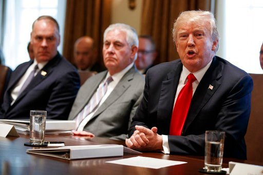 (AP Photo/Evan Vucci). President Donald Trump speaks during a cabinet meeting at the White House, Wednesday, Jan. 10, 2018, in Washington. From left, Secretary of Interior Ryan Zinke, Secretary of State Rex Tillerson, and Trump.