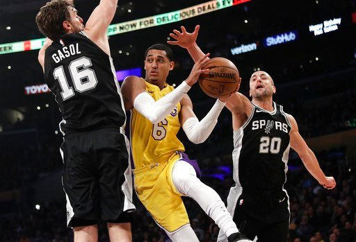 (AP Photo/Jae C. Hong). Los Angeles Lakers' Jordan Clarkson, center, is double-teamed by San Antonio Spurs' Pau Gasol, left, of Spain, and Manu Ginobili, of Argentina, during the first half of an NBA basketball game Thursday, Jan. 11, 2018, in Los Ange...