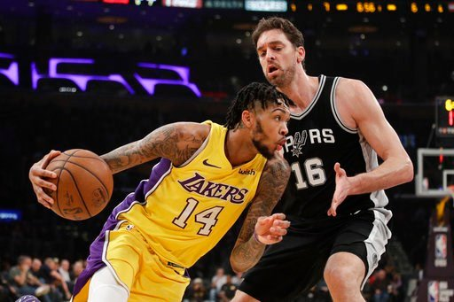 (AP Photo/Jae C. Hong). Los Angeles Lakers' Brandon Ingram, left, drives past San Antonio Spurs' Pau Gasol, of Spain, during the first half of an NBA basketball game Thursday, Jan. 11, 2018, in Los Angeles.