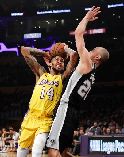 (AP Photo/Jae C. Hong). Los Angeles Lakers' Brandon Ingram, left, is pressured by San Antonio Spurs' Manu Ginobili, of Argentina, during the first half of an NBA basketball game Thursday, Jan. 11, 2018, in Los Angeles.