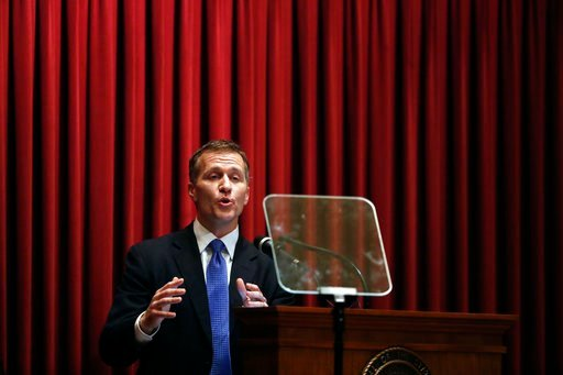 (AP Photo/Jeff Roberson, File). FILE - In this Wednesday, Jan. 10, 2018 file photo, Missouri Gov. Eric Greitens delivers the annual State of the State address to a joint session of the House and Senate, in Jefferson City, Mo. Greitens appears to be bra...