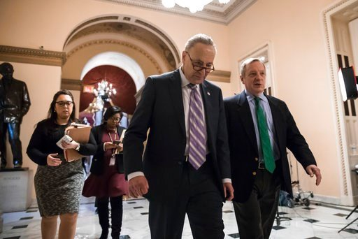 (AP Photo/J. Scott Applewhite). Senate Minority Leader Chuck Schumer, D-N.Y., left, walks with Sen. Dick Durbin, D-Ill., the minority whip, as lawmakers continue negotiating on a deal.