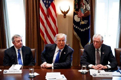 (AP Photo/Evan Vucci). In this Jan. 9, 2017, photo, Sen. Dick Durbin, D-Ill., left, and Rep. Steny Hoyer, D-Md. listen as President Donald Trump speaks during a meeting with lawmakers on immigration policy in the Cabinet Room of the White House.