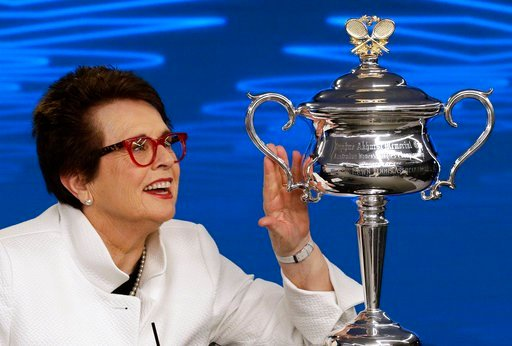 (AP Photo/Mark Baker). Billie Jean King, former ladies singles champion holds the Daphne Akhurst Memorial Cup during a press conference ahead of the Australian Open tennis championships in Melbourne, Australia Friday, Jan. 12, 2018. King is in Melbourn...