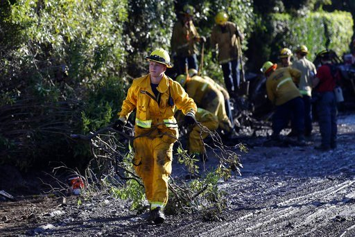 (AP Photo/Marcio Jose Sanchez). A firefighter cleans debris from an area damaged by storms in Montecito, Calif., Thursday, Jan. 11, 2018.