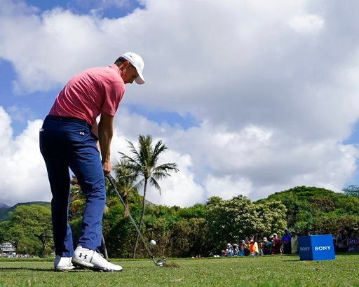 (AP Photo/Marco Garcia). Jordan Spieth drives off the seventh tee during the first round of the Sony Open golf tournament, Thursday, Jan. 11, 2018, in Honolulu.