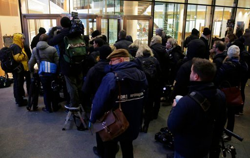 (AP Photo/Markus Schreiber). Journalists queue outside the Social Democrats party headquarters when waiting for statements after the exploratory talks between Merkel's Christian Democratic block and the Social Democrats on forming a new German governme...