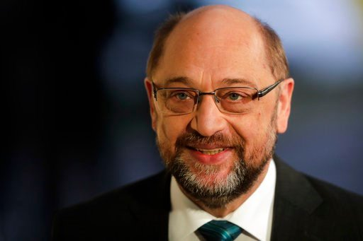 (AP Photo/Markus Schreiber). Social Democratic Party, SPD, chairman Martin Schulz arrives for a statement prior to exploratory talks about a new German government between German Chancellor Angela Merkel's Christian Unions block and his party at the SPD...