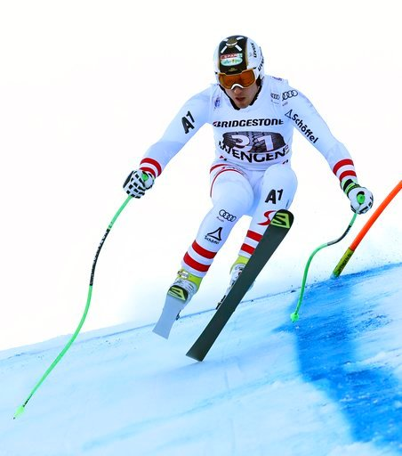 (AP Photo/Alessandro Trovati). Austria's Hannes Reichelt competes during the first portion of an alpine ski, men's World Cup combined race, in Wengen, Switzerland, Friday, Jan. 12, 2018.