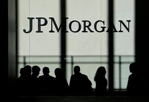 (AP Photo/Seth Wenig, File). FILE - In this Monday, Oct. 21, 2013, file photo, the JPMorgan Chase & Co. logo is displayed at their headquarters in New York. JPMorgan Chase & Co. reports earnings, Friday, Jan. 12, 2018.