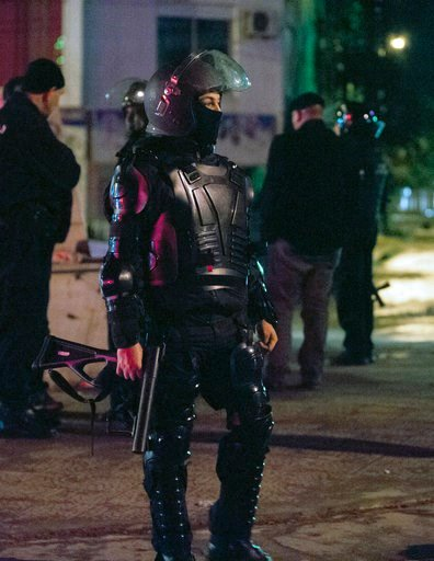 (AP Photo/Riadh Dridi). Riot police officer patrols the district of Intilaka, north of Tunis, Tunisia, Thursday Jan. 11, 2018. Tunisian authorities say over two hundred people have been detained in recent days as violent protests against government-imp...