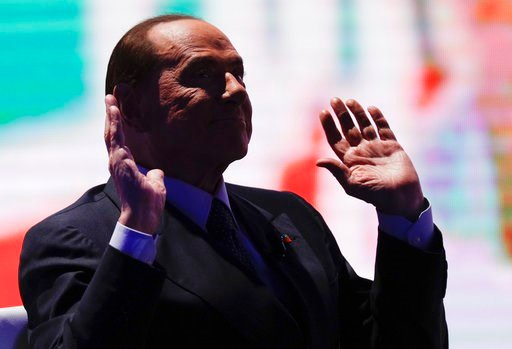 (AP Photo/Andrew Medichini). Italian former Prime Minister and Forza Italia (Go Italy) party leader, Silvio Berlusconi, attends the recording of the Italian state television RAI, Porta a Porta (Door To Door) talk show in Rome, Thursday, Jan. 11, 2018.