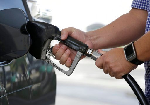 (AP Photo/Lynne Sladky, File). FILE - In this Jan. 23, 2015 file photo, a motorist refuels his vehicle at a Westar gas station in Miami.  Consumer inflation slowed in December 2017 to a tiny 0.1 percent gain as the cost of energy products tumbled after...