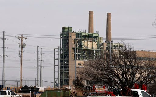 (AP Photo/Sue Ogrocki). OG&E's Mustang Energy Center power plant is pictured in Oklahoma City, Wednesday, Jan. 10, 2018. Oklahoma Attorney General Mike Hunter has asked for a reduction in customer utility rates from the state's leading utility comp...