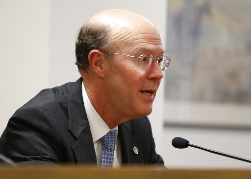(AP Photo/Sue Ogrocki, File). FILE - In this Wednesday, Dec. 2, 2015 file photo, Bob Anthony, chairman of the Oklahoma Corporation Commission, speaks during a meeting in Oklahoma City. Public utility regulators nationwide are re-examining rates that ho...