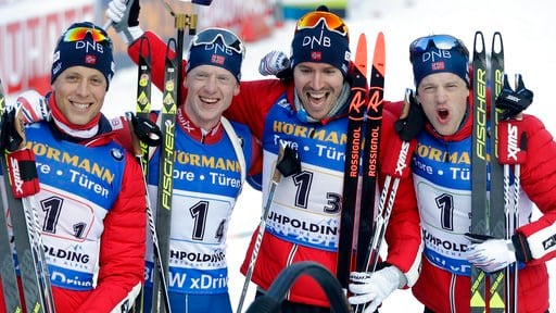 (AP Photo/Matthias Schrader). Norway's Lars Helge Birkeland, from left, Johannes Thingnes Boe, Emil Hegle Svendsen and Tarjei Boe celebrate after winning the men's 4x7.5km relay competition at the biathlon World Cup in Ruhpolding, Germany, Friday, Jan....