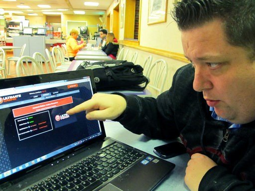 (AP Photo/Wayne Parry). In this Nov. 21, 2013, photo, Joseph Brennen tries to log on to a gambling site while at a highway rest stop in Egg Harbor Township N.J., on the first night of New Jersey's Internet gambling test. On Thursday, Jan. 11, 2018, New...