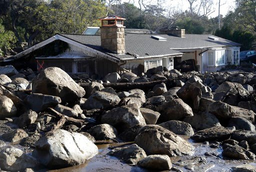 (AP Photo/Marcio Jose Sanchez). Large rocks and mud are shown in front of a house in Montecito, Calif., Thursday, Jan. 11, 2018. Hundreds of rescue workers slogged through knee-deep ooze and used long poles to probe for bodies Thursday as the search dr...