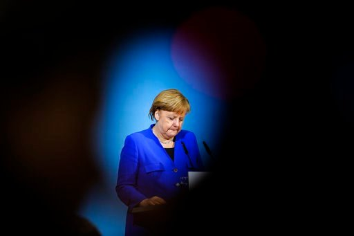 (AP Photo/Markus Schreiber). German Chancellor Angela Merkel attends a joint statement after the exploratory talks between Merkel's conservative bloc and the Social Democrats on forming a new German government in Berlin, Germany, Friday, Jan. 12, 2018.