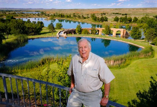 (Tom Fox/The Dallas Morning News via AP, File). FILE - In this May 30, 2017, file photo, oil tycoon T. Boone Pickens poses for a photo before a series of man-made lakes leading from The Lake House to The Lodge on his Mesa Vista Ranch in the panhandle o...