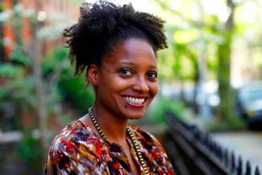 (AP Photo/Jason DeCrow, File). FILE - In this April 16, 2012 file photo, Pulitzer Prize winning poet Tracy K. Smith poses outside her apartment in New York. Smith has embarked on the first of several trips to bring her poetry to rural pockets of the co...