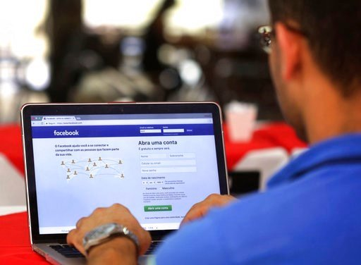 (AP Photo/Eraldo Peres, File). FILE - In this Thursday, Jan. 4, 2018, file photo, a man demonstrates how he enters his Facebook page as he works on his computer at a restaurant in Brasilia, Brazil. Facebook is once again tweaking the formula it uses to...