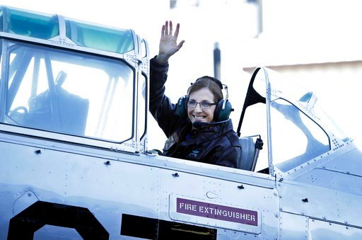 (AP Photo/Rick Scuteri). U.S. Rep. Martha McSally, R-Ariz., waves from a T-6 World War II airplane as she leaves for Phoenix, Friday, Jan. 12, 2018, in Tucson, Ariz. McSally announced Friday that she is running for the U.S. Senate seat being vacated by...