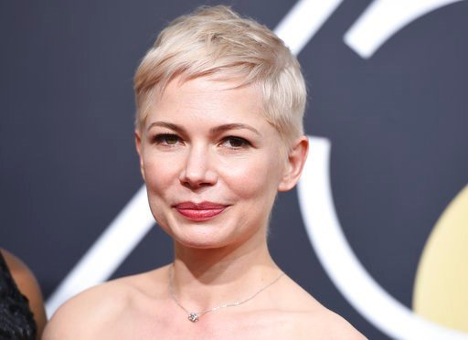 (Photo by Jordan Strauss/Invision/AP). Michelle Williams arrives at the 75th annual Golden Globe Awards at the Beverly Hilton Hotel on Sunday, Jan. 7, 2018, in Beverly Hills, Calif.