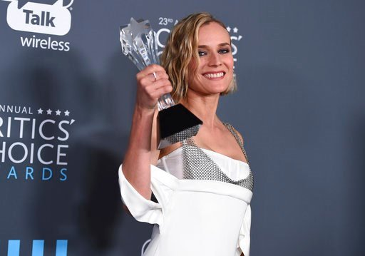 "(Photo by Jordan Strauss/Invision/AP). Diane Kruger, winner of the award for best foreign language film for ""In The Fade"", poses in the press room at the 23rd annual Critics' Choice Awards at the Barker Hangar on Thursday, Jan. 11, 2018, in Santa Monic..."