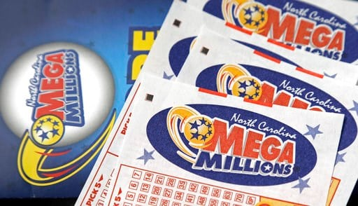(AP Photo/Gerry Broome, File). FILE - In this July 1, 2016, file photo, Mega Millions lottery tickets rest on a counter at a Pilot travel center near Burlington, N.C.  The jackpot for the Mega Millions lottery game has climbed to over $450 million, jus...