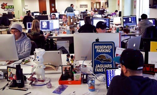 (AP Photo/Charles Krupa). In this Thursday, Jan. 11, 2018 photo, employees work at the DraftKings office in Boston. The leading daily fantasy sports company has launched a new sports game that lets users hone in on a single NFL football playoff game, w...