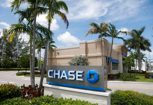 (AP Photo/Wilfredo Lee, File). FILE - This Wednesday, Aug. 17, 2016, file photo, shows a Chase bank branch in North Miami Beach, Fla. JPMorgan Chase & Co. reports earnings, Friday, Jan. 12, 2018.