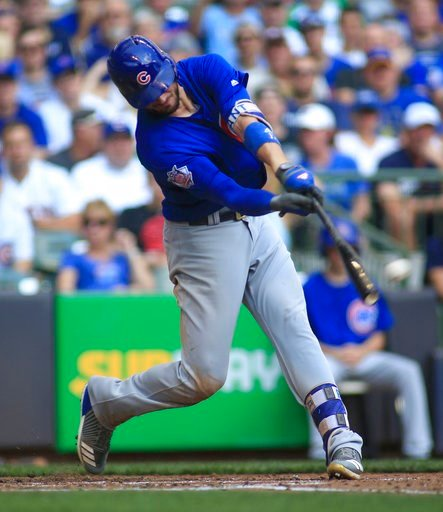 (AP Photo/Darren Hauck, File). FILE - In this Sept. 24, 2017, file photo, Chicago Cubs third baseman Kris Bryant hits an RBI-double against the Milwaukee Brewers during the fourth inning of an baseball game in Milwaukee. The hot corner figures to be sm...
