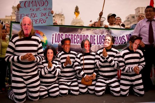 (AP Photo/Rodrigo Abd, File). FILE - In this Jan. 19, 2017 file photo, people wearing masks of Peruvian politicians pretend to be prisoners during a protest calling for justice after the Odebrecht corruption scandal in Lima, Peru. Pope Francis frequent...