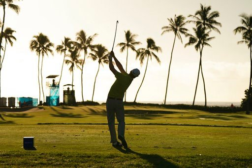 (AP Photo/Marco Garcia). Zach Johnson hits off the 11th tee during the second round of the Sony Open golf tournament, Friday, Jan. 12, 2018, in Honolulu.