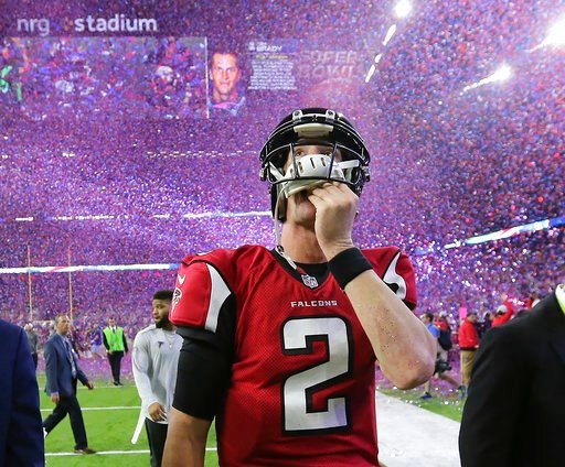 (Curtis Compton/Atlanta Journal-Constitution via AP, File). FILE - In this photo taken Feb. 5, 2017, file photo, Atlanta Falcons quarterback Matt Ryan reacts after losing Super Bowl 51 as the screen flashes New England Patriots quarterback Tom Brady an...
