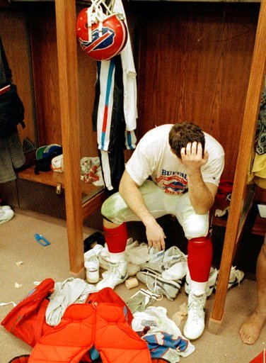 (AP Photo/Lennox McLendon, File). FILE - In this Jan. 27, 1991, file photo, Buffalo Bills' Mark Pike sits in the locker room afterhis team lost Super Bowl XXV to the New York Giants in Tampa, Fla. The Bills lost four straight Super Bowls in the early 1...