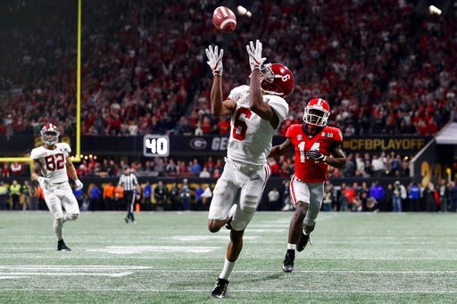 (AJ Reynolds/Athens Banner-Herald via AP). Alabama wide receiver DeVonta Smith (6) scores the game winning touchdown in overtime during the College Football Playoff National Championship game between Georgia and Alabama on Monday, Jan. 8, 2017 in Atlan...