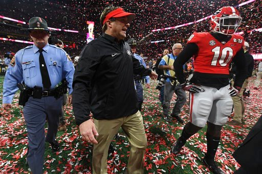 (AJ Reynolds/Athens Banner-Herald via AP). Georgia head coach Kirby Smart and Georgia defensive back Malik Herring (10) walk off the field after the College Football Playoff National Championship game between Georgia and Alabama on Monday, Jan. 8, 2017...