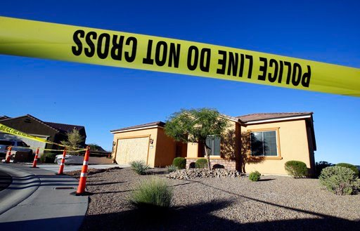 (AP Photo/Chris Carlson, File). FILE - This Oct. 2, 2017 file photo shows police tape blocking off the home of Stephen Craig Paddock in Mesquite, Nev. A federal judge is being asked to unseal documents telling what federal agents learned before searchi...