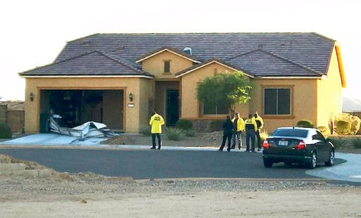 (Mesquite Police Department via AP, File). FILE - This Oct. 2, 2017 file photo provided by the Mesquite, Nev., Police Department shows police personnel stand outside the home of Stephen Paddock on Monday, Oct. 2, 2017, in Mesquite. A federal judge is b...