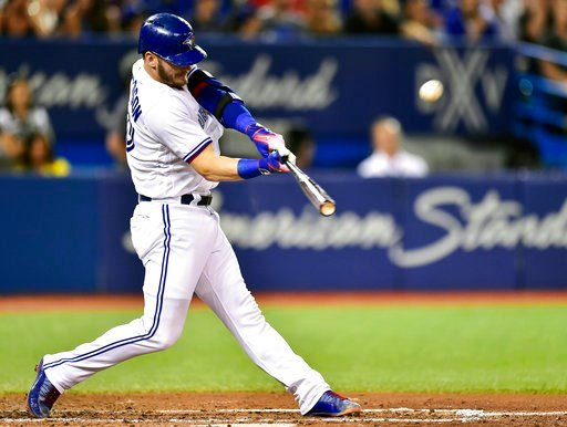 (Frank Gunn/The Canadian Press via AP, File). FILE - In this Aug. 15, 2017, file photo, Toronto Blue Jays' Josh Donaldson hits a three-run home run against the Tampa Bay Rays during the fifth inning of a baseball game in Toronto. The hot corner figures...