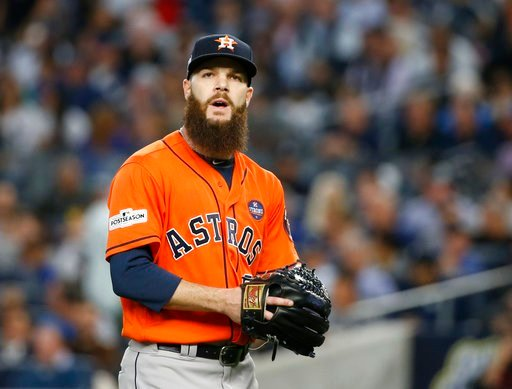 (AP Photo/Kathy Willens, File). FILE - In this Oct. 18, 2017, file photo, Houston Astros starting pitcher Dallas Keuchel walks back to the dugout after the third inning of Game 5 of the baseball team's American League Championship Series against the Ne...
