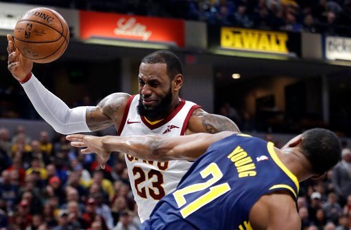 (AP Photo/Darron Cummings). Cleveland Cavaliers' LeBron James (23) is fouled by Indiana Pacers' Thaddeus Young as he goes up to shoot during the first half of an NBA basketball game, Friday, Jan. 12, 2018, in Indianapolis.