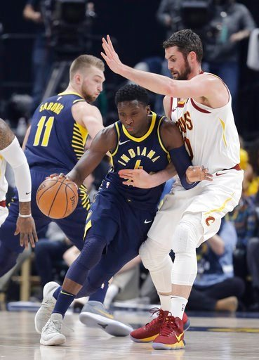 (AP Photo/Darron Cummings). Indiana Pacers' Victor Oladipo (4) is defended by Cleveland Cavaliers' Kevin Love during the first half of an NBA basketball game, Friday, Jan. 12, 2018, in Indianapolis.