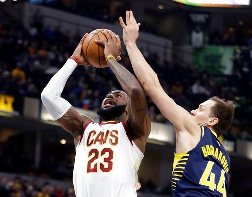 (AP Photo/Darron Cummings). Cleveland Cavaliers' LeBron James (23) shoots against Indiana Pacers' Bojan Bogdanovic during the first half of an NBA basketball game, Friday, Jan. 12, 2018, in Indianapolis.