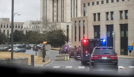 (AP Photo/Carolyn Kaster). President Donald Trump's motorcade, seen from the media van, arrives at Walter Reed National Military Medical Center in Bethesda, Md, Friday, Jan. 12, 2018, where he will have his first medical check-up as president.