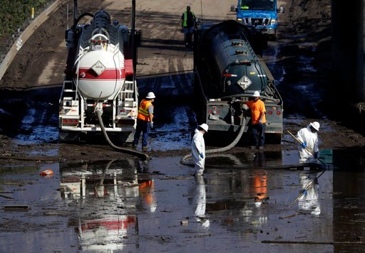 (AP Photo/Marcio Jose Sanchez). A work crew cleans up an area of Highway 101 that flooded in Montecito, Calif., Friday, Jan. 12, 2018. The number of missing after a California mudslide has fluctuated wildly, due to shifting definitions, the inherent un...
